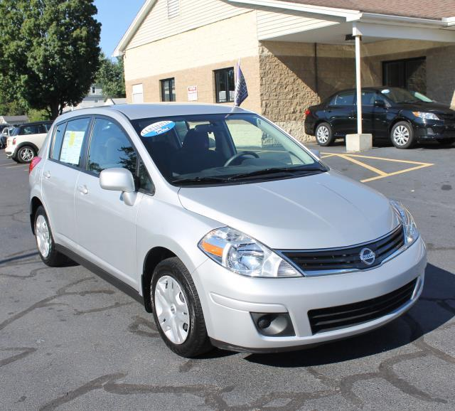 2012 Nissan Versa Versa Compact spare tire Body color frontrear bumpers Multi-reflector halogen